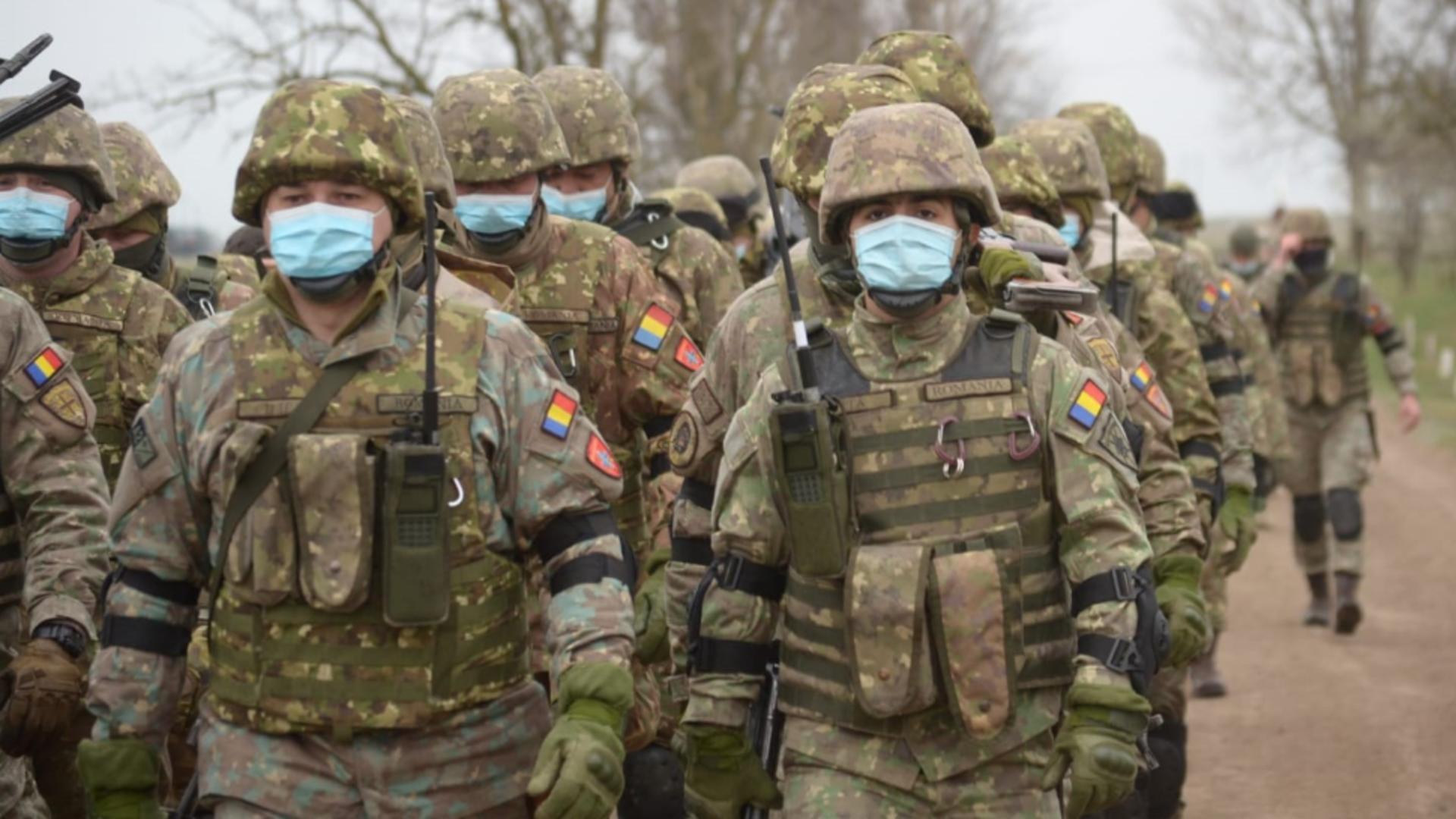 Peste 700 de militari români se întorc din Afganistan în următoarele luni - Decizia NATO