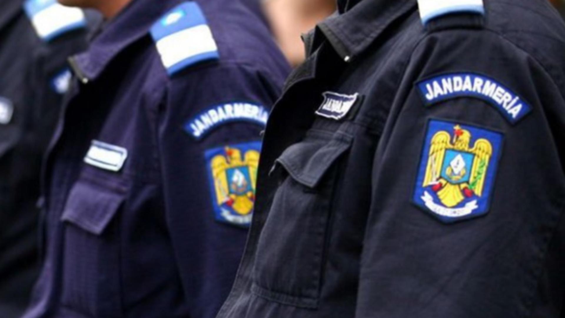 Un jandarm a luat pistolul aflat pe biroul unui polițist și a tras accidental un foc în podea